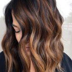 Candy Balayage Dark brown hair with reflections is undeniably