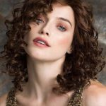 Long curls charged with volume and personality. Create endless style and power options