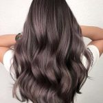 Long curly brunette hairstyle with layers