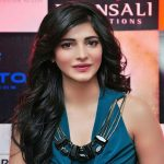 Shruti Haasan opted for a knotted shirt and harem pants,