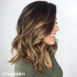 Medium length hair with waves and texture.