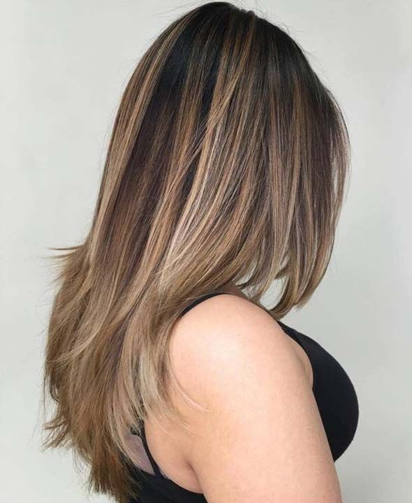 Dark hair is a lovely way to light up your look