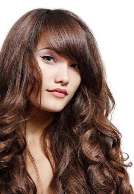 Long-layered hairstyles with side bangs swept